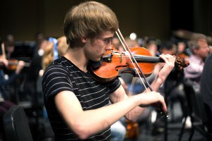 Evan Johanson performing the violin