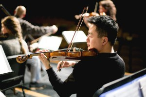 Violin performed by professional accompanying the students