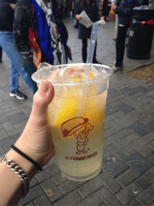 Lemonade in a cup adorned with a tiny anthropomorphic wiener. Excellent.
