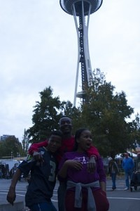 From right to left: Lengz, Sizla, and Yolanda in front of Seattle's iconic Space Needle