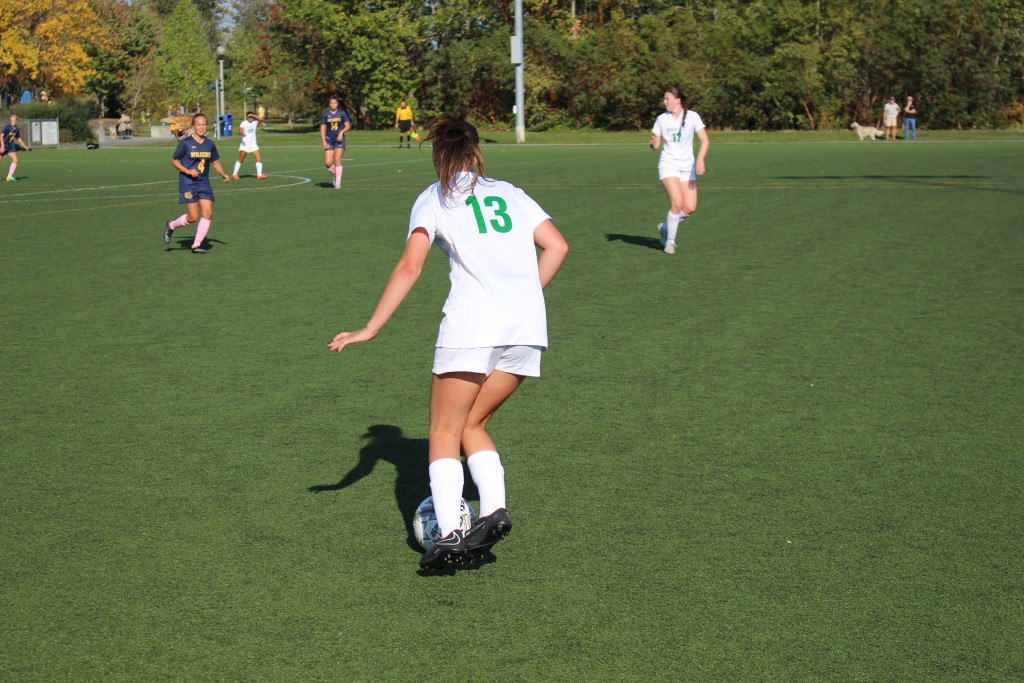 Freshman Cate Rogerson competed in the varsity game against West Seattle last week. Photo by Ryan Henrie