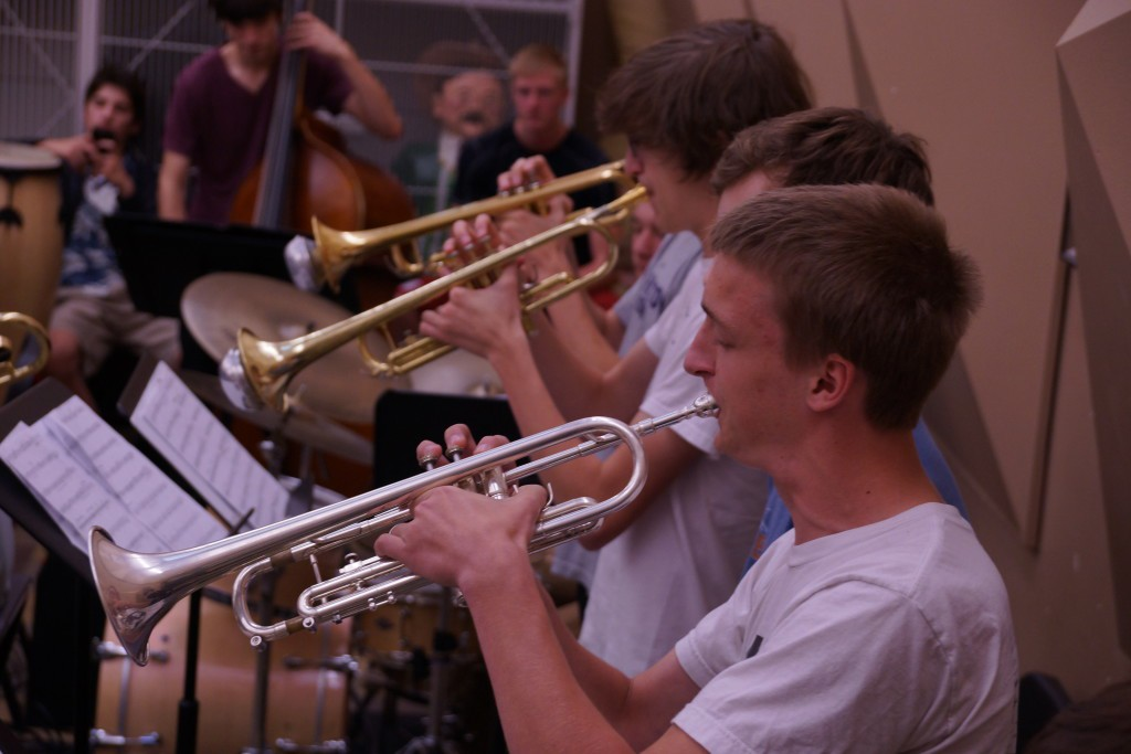 Junior Thomas Hinds rehearses alongside the rest of the trumpet section. Photo by Conor Courtney