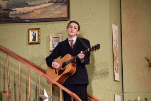Junior Duncan Weinland pays the guitar at the Thursday Night performance. Photo by Nathan Smith