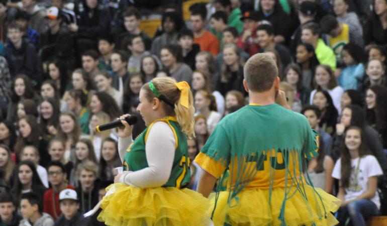 Seniors Bella del Valle and Micah Huie MC for the Spring Assembly